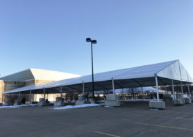 60′ x 131′ Clearspan Losberger tent at 500 Bell STreet, Dubuque Street for Jurassic Quest Enterprises