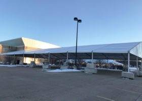 Finished 60′ x 131′ (18m x 40m) Losberger tent with dead weight
