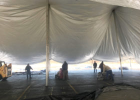 Setting up a 80′ x 120′ rope and pole tent at Kelly's Irish Pub for Saint Patrick's Day 2017 in Davenport, Iowa