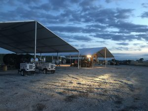 18m x 20m (60′ x 66') Clearspan Tent on the left and a 40′ x 60′ Clearspan Tent on the right at dusk