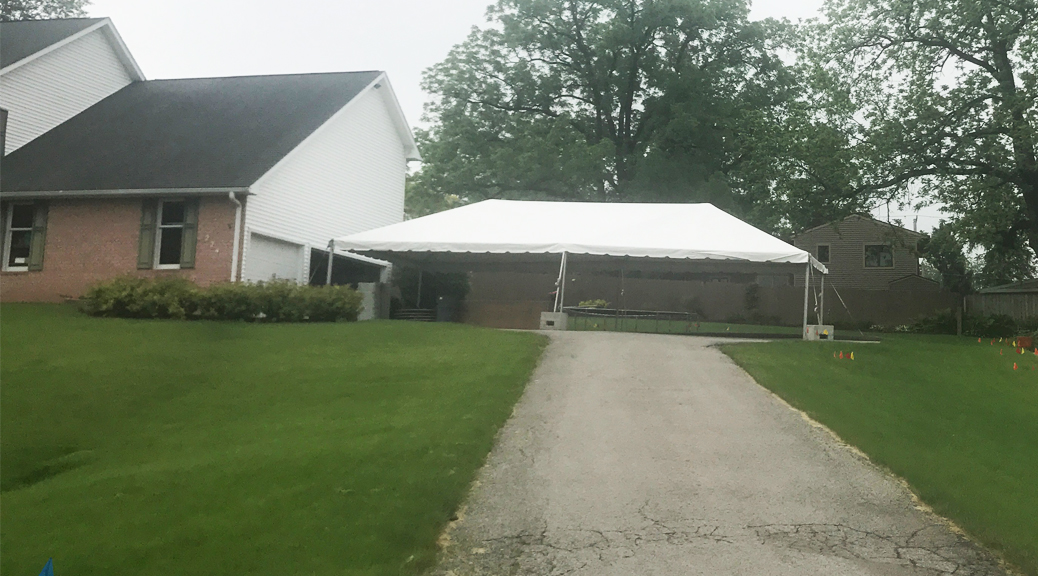 20' x 40' frame tent next to a home for Graduation Party