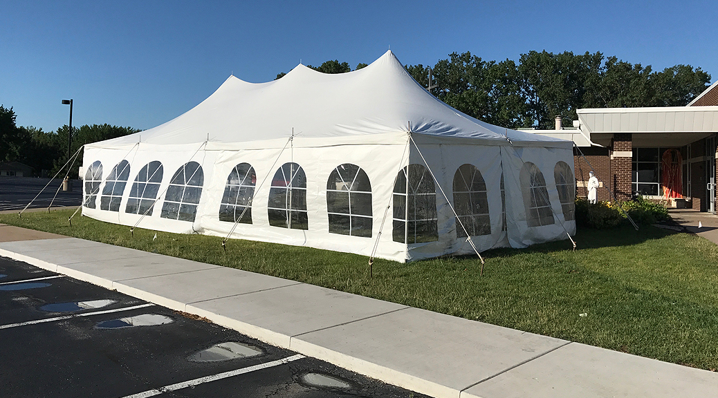 20' x 40' rope and pole tent with French Sidewalls for a wedding reception at a St John Vianney Church in Bettendorf, IA