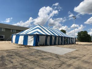 30' x 60' blue and white rope and pole tent for Fireworks Stand setup in Clinton, Iowa
