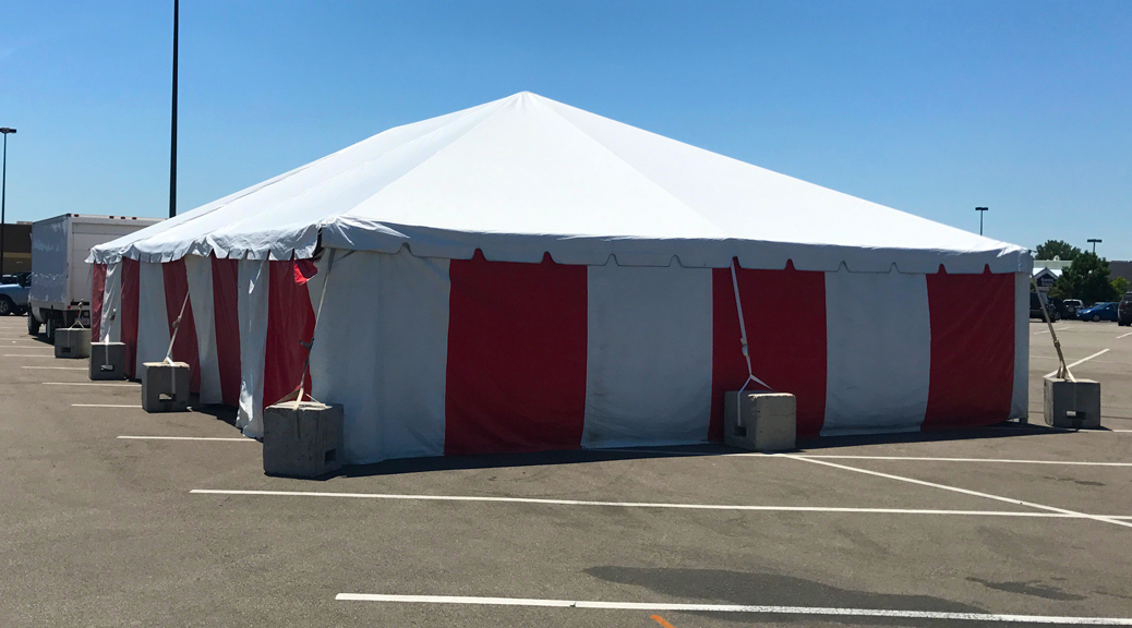 30' x 60' frame fireworks stand tent at the Walmart Supercenter in Cedar Rapids, Iowa with red and white side walls