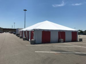 30' x 60' frame tent at the Walmart Supercenter in Cedar Rapids, Iowa with red and white side walls for Fireworks stand in the parking lot