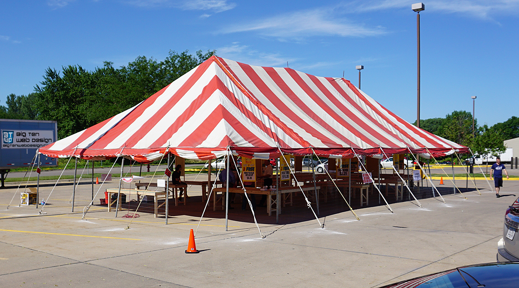 30' x 60' red and white rope and pole fireworks tent at Fareway Grocery at Westwinds Dr in Iowa City, IA