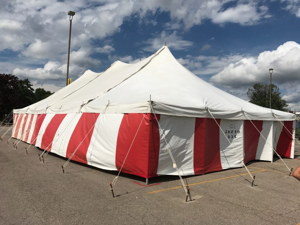 30' x 60' rope and Pole tent with red and white side walls for a Fireworks tent atHy-Vee in Davenport