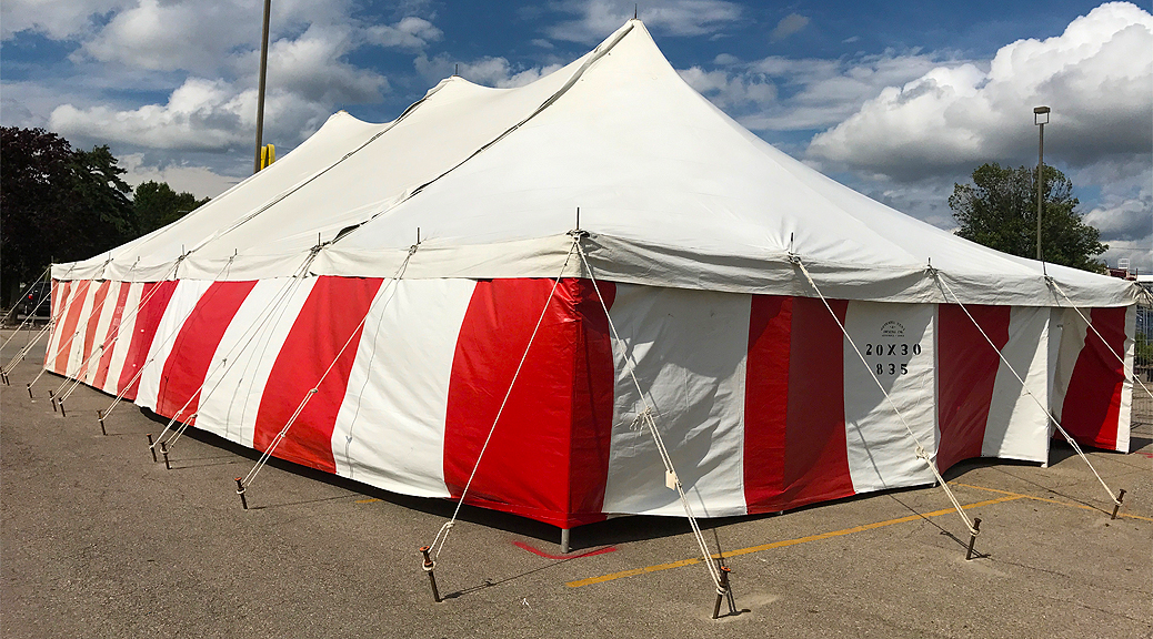 30' x 60' rope and Pole tent with red and white side walls for a Fireworks tent atHy-Vee in Davenport, Iowa