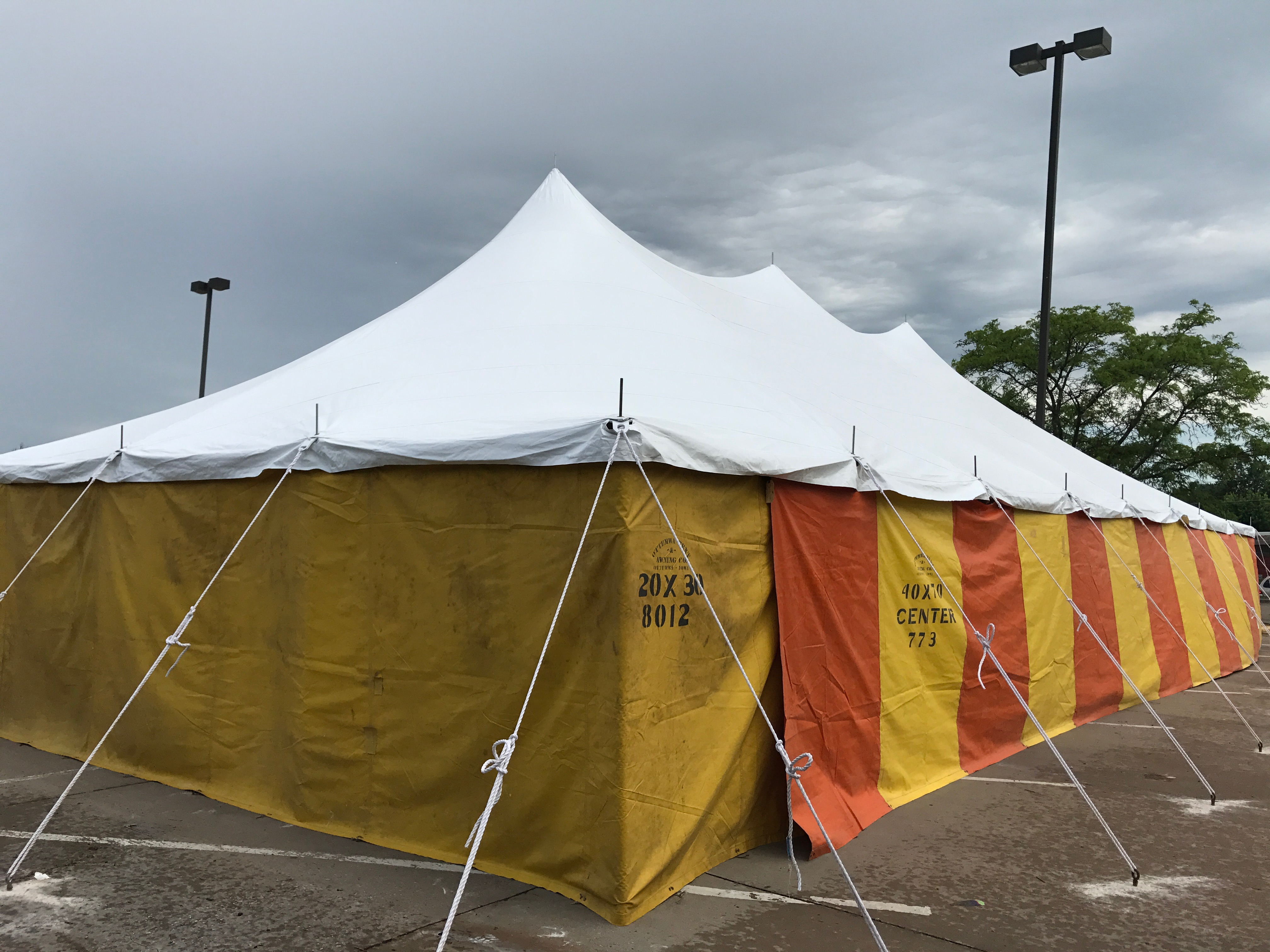 30' x 60' rope and pole tent at Hy-Vee 1823 E Kimberly Rd in Davenport, Iowa with Yellow and Orange side walls