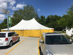 40' x 60' rope and pole fireworks tent at HyVee on Dodge St. in Iowa City with yellow sidewalls
