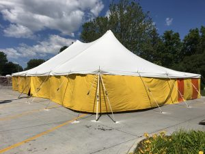 40' x 60' rope and pole fireworks tent with yellow sidewalls at HyVee on Dodge St. in Iowa City for Bellino Fireworks