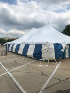 40' x 60' rope and pole tent with Blue and White Sidewall at Hy-Vee in Cedar Rapids using concrete bolts