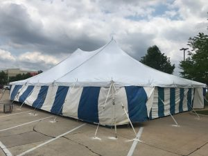 40' x 60' rope and pole tent with Blue and White Sidewall used for Fireworks tent at Hy-Vee in Cedar Rapids