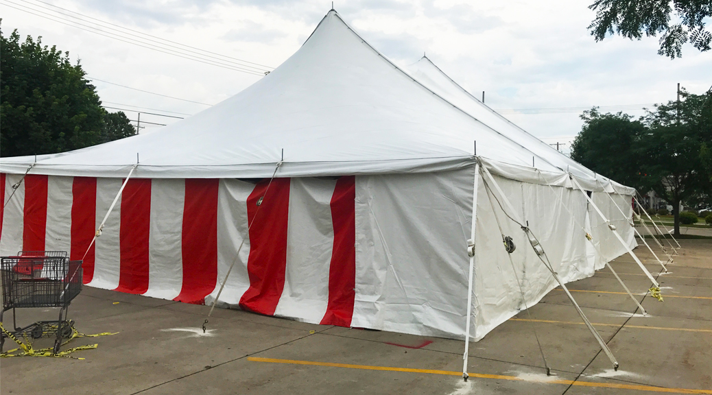 40' x 60' rope and pole tent with Red and White Sidewall used for Fireworks tent at Hy-Vee in Cedar Rapids