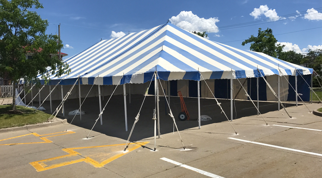 40' x 70' blue and white rope and pole tent at Hy-Vee S. 1st Ave in Iowa City for Bellino Fireworks