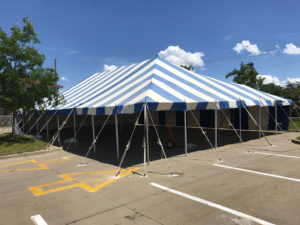 40' x 70' blue and white rope and pole tent for fireworks stand at Hy-Vee S. 1st Ave in Iowa City for Bellino Fireworks