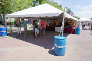 Beer sales under the Beverage Garden tent at Summer of the Arts