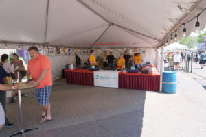 Beer sales under the Beverage Garden tent at Summer of the Arts with BlendCard
