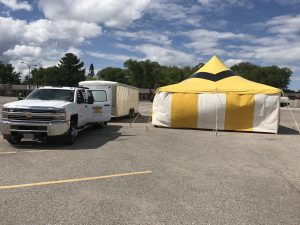 Big Ten Rentals sets up a 20' x 40' rope and pole fireworks tent for Ka-Boomers Fireworks at Maple Lanes Bowling Center in Waterloo, Iowa