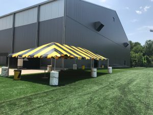 Black and Gold tent for the Ladies Football Academy at the University of Iowa 2017