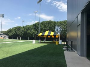 Black and Gold tent for the Ladies Football Academy at the University of Iowa by the football training field