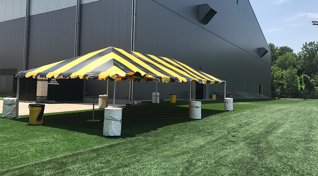 Black and Gold tent for the Ladies Football Academy at the University of Iowa