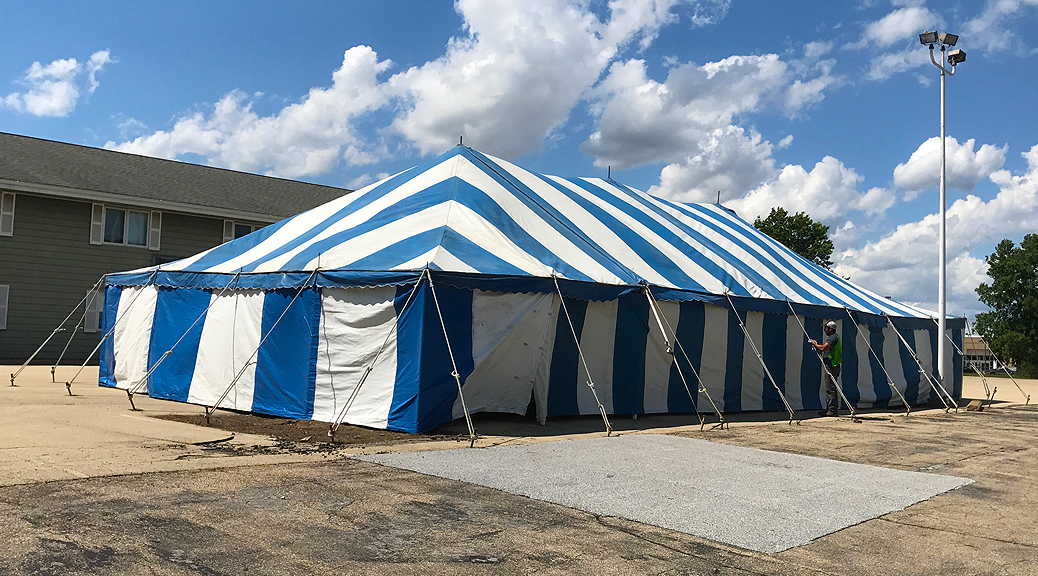 Blue and white rope and pole tent for Fireworks Stand setup in Clinton, Iowa