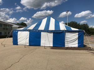 End of the 30' x 60' blue and white rope and pole tent for Fireworks Stand setup in Clinton, IA