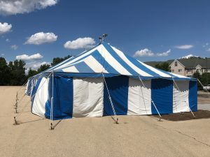 End of the 30' x 60' blue and white rope and pole tent for Fireworks Stand setup in Clinton, Iowa