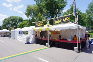 First Aid tent and Volunteer Check-in tent at Summer of the Arts