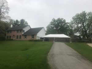 Home with 20' x 40' frame tent next to it for Graduation Party