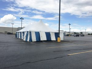30' x 60' rope and pole tent with blue and white sidewall for Ka-Boomers Fireworks stand at Blain's Farm & Fleet parking lot in Cedar Falls, Iowa