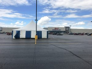 30' x 60' rope and pole tent with blue and white sidewall for Ka-Boomers Fireworks stand in Cedar Falls, Iowa