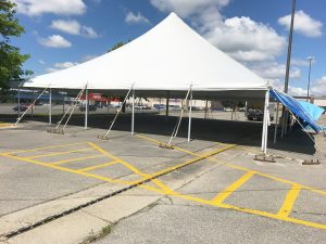 Large 60' x 60' rope and pole tent for fireworks stand in Marion, IA for Bellino Fireworks