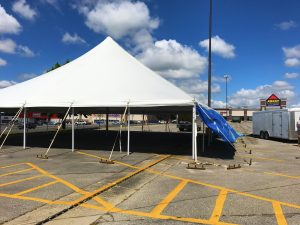 Large 60' x 60' rope and pole tent for fireworks stand in Marion, Iowa for Bellino Fireworks