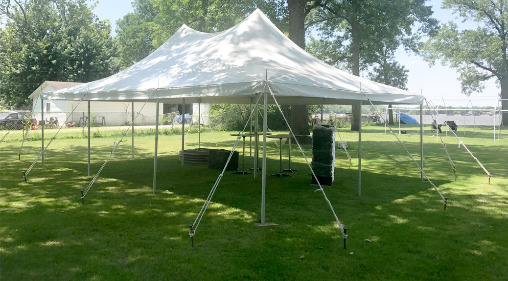 Outdoor Graduation party under 20' x 30' rope and pole tent in East Moline, Illinois