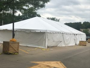 Outside of a 30' x 60' frame tent with white sidewalls for a fireworks stand at Hy-Vee in Cedar Rapids, IA