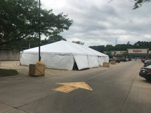 Outside of a 30' x 60' frame tent with white sidewalls for a fireworks stand at Hy-Vee in Cedar Rapids, Iowa