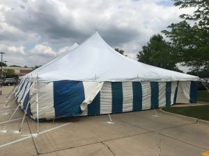 Outside of a 40' x 60' rope and pole tent with Blue and White Sidewall used for Fireworks tent at Hy-Vee in Cedar Rapids