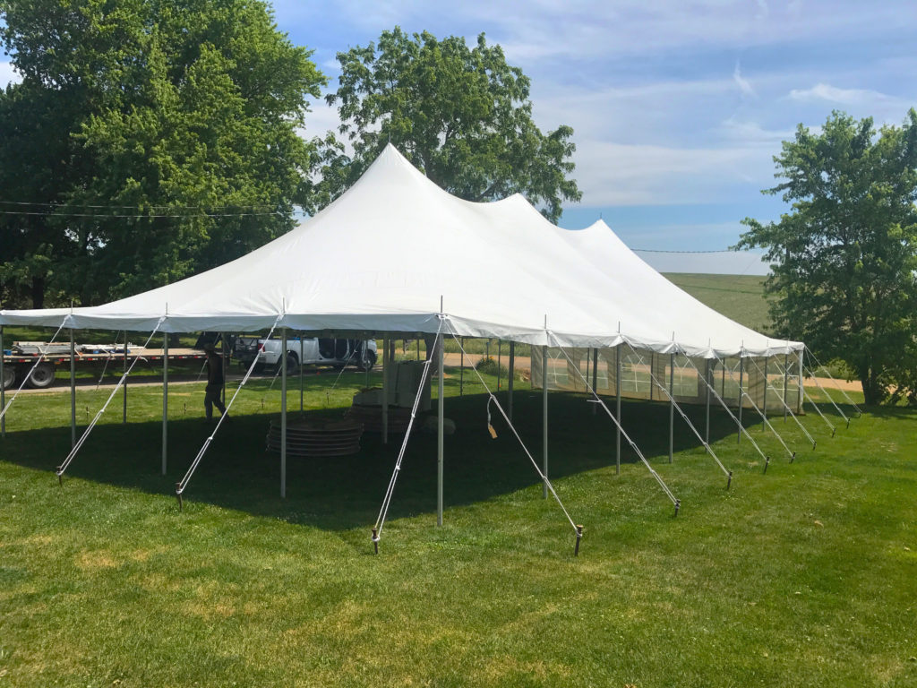 Outside of the 30' x 60' rope and pole wedding tent in De Witt, Iowa