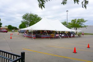 Outside of the 40' x 60' rope and pole tent for Fireworks Stand Hy-Vee 1720 Waterfront Dr, Iowa City, IA 52240