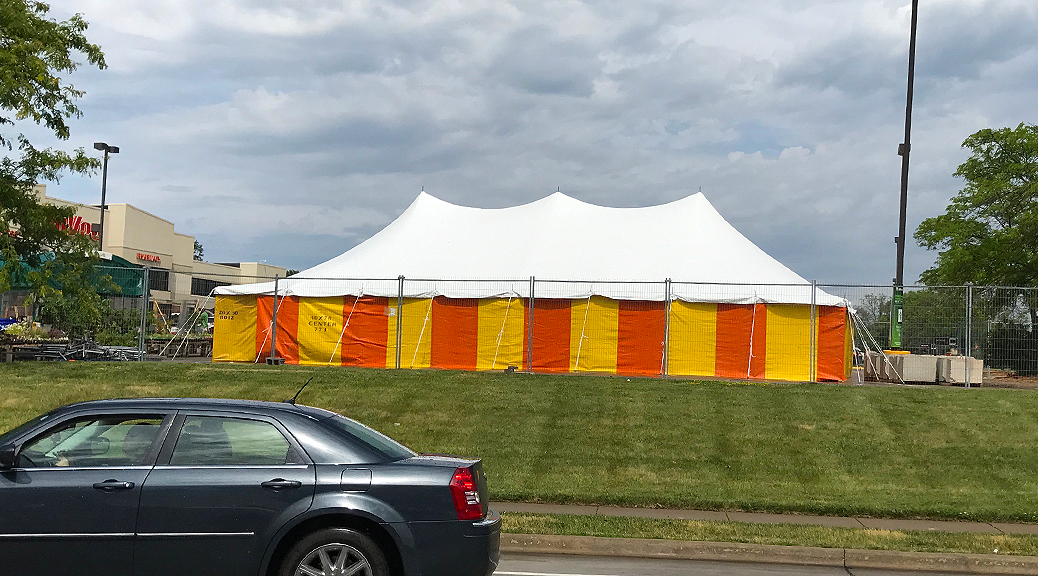 Outside the 30' x 60' rope and pole tent at Hy-Vee 1823 E Kimberly Rd in Davenport, Iowa with Yellow and Orange side walls