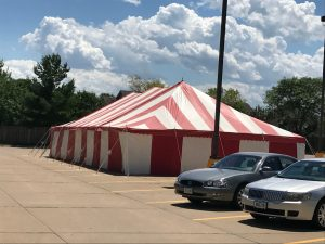 Red And White 30' x 60' rope and pole tent at Fareway Grocery in Davenport, Iowa