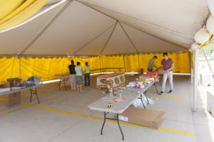 Setting up a fireworks stand at Walmart Supercenter in Iowa City, IA under a 30' x 45' frame tent