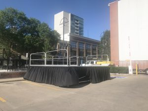 Setup of a 16' x 16' stage on 48 legs in downtown Iowa City for the Iowa City Block Party in 2017