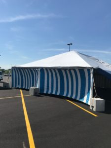 Side of 30' x 60' frame tent at the Walmart Supercenter in Cedar Rapids, Iowa with blue and white side walls