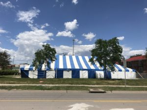 Side of 40' x 70' blue and white rope and pole tent at Hy-Vee S. 1st Ave in Iowa City for Bellino Fireworks