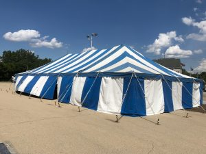 Side of the 30' x 60' blue and white rope and pole tent for Fireworks Stand setup in Clinton, Iowa