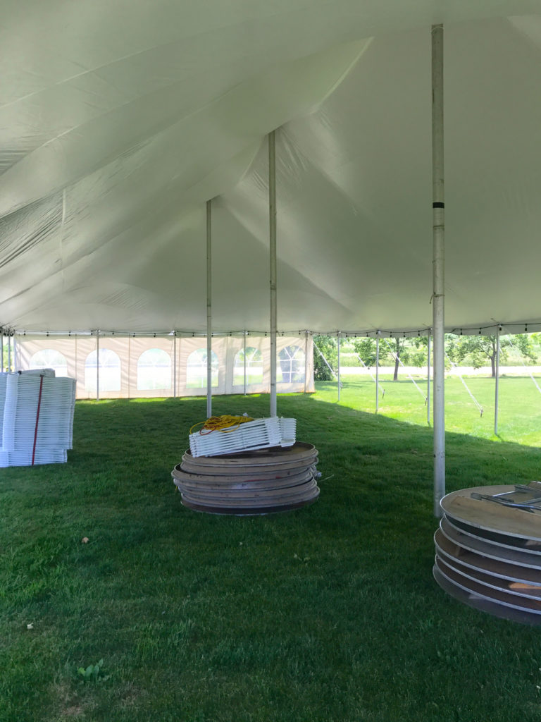 Under a 30' x 60' rope and pole wedding tent in De Witt, Iowa