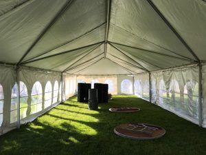 Under the 20' x 60' frame tent with French Sidewalls for a wedding reception at a St John Vianney Church in Bettendorf IA